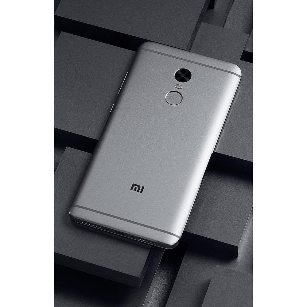 Смартфон Xiaomi Redmi Note 4X 32Gb серый в интерьере - фото 2